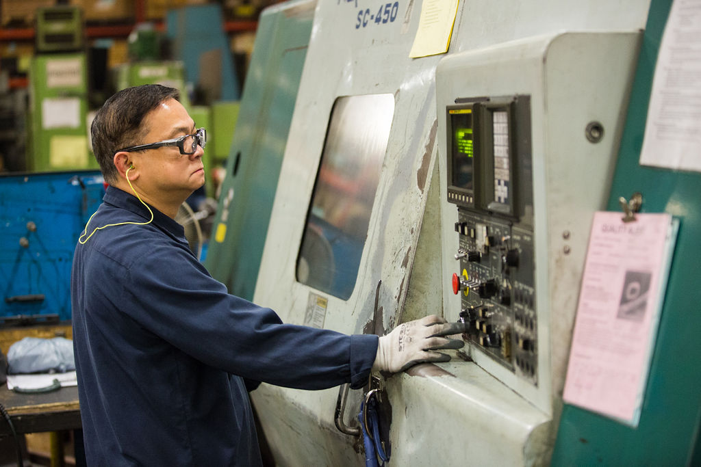 A Worker Using a Manufacturing Machine - CGL Manufacturing, Machining, Turning, Castings, Forgings, Fabrications, Assemblies, Components & China Machining
