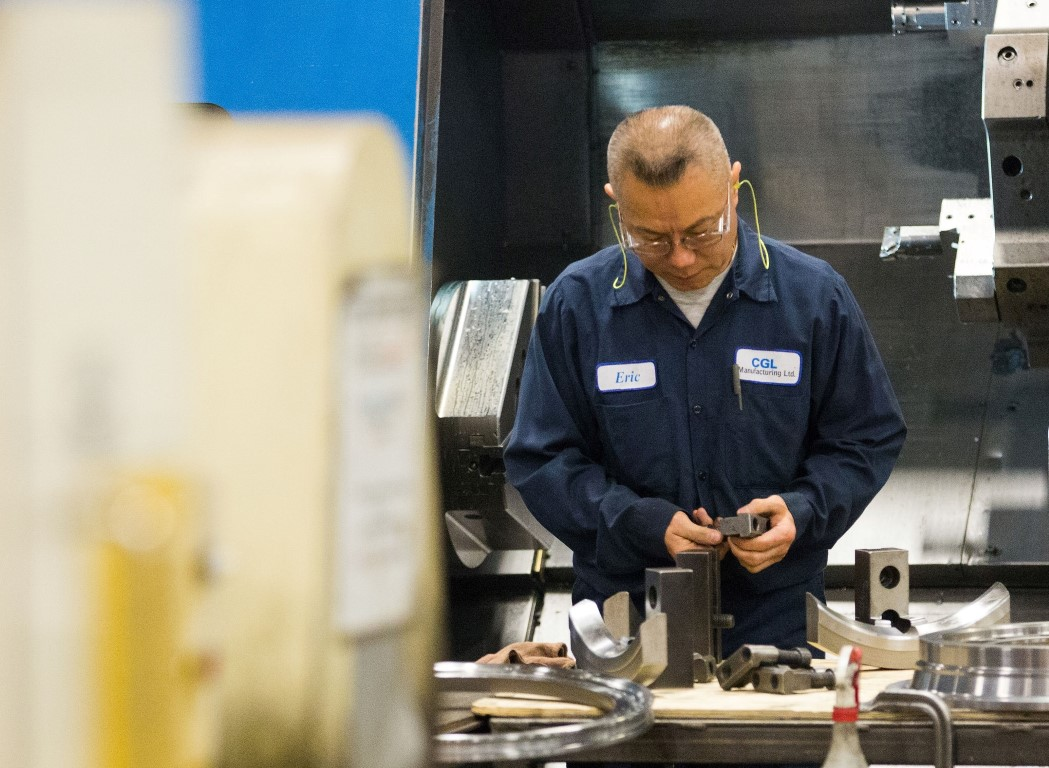A Man Examining a Piece of Steel - CGL Manufacturing, Machining, Turning, Castings, Forgings, Fabrications, Assemblies, Components & China Machining