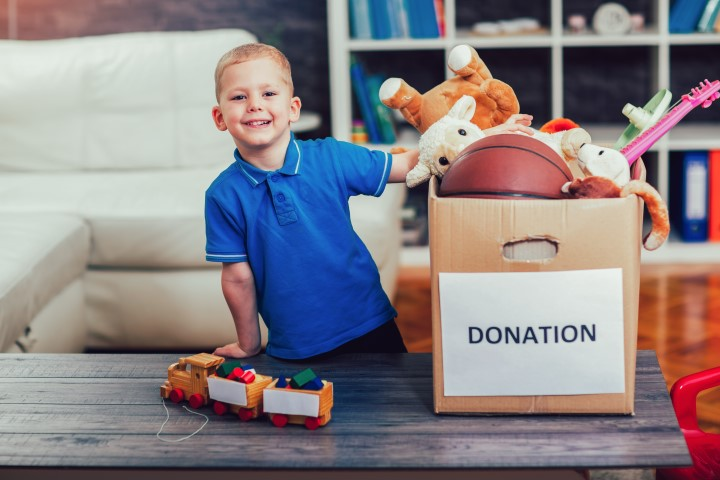 Boy With a Donation Box Full of Toys - CGL Manufacturing, Machining, Turning, Castings, Forgings, Fabrications, Assemblies, Components & China Machining
